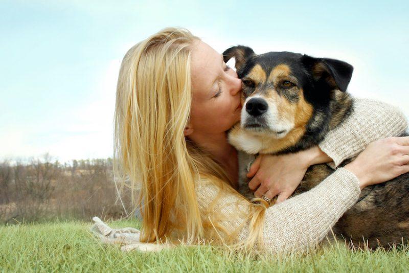 hugging a dog